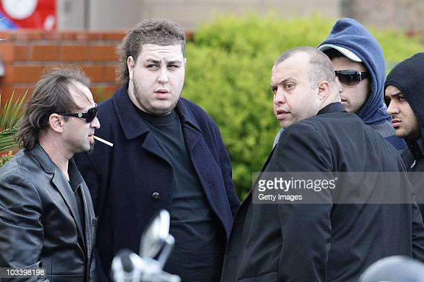 Omar Chaouk the son of Macchour Chaouk greets mourners after the funeral for Melbourne crime figure Macchour Chaouk at Preston Mosque on August 16...
