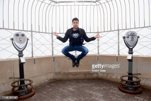 Omar Chaparro visits The Empire State Building on May 03 2019 in New York City
