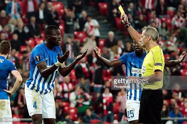 Omar Colley of KRC Genk receives a yellow card from referee Martin Atkinson for making a penalty fault pictured during the UEFA Europa League group F...