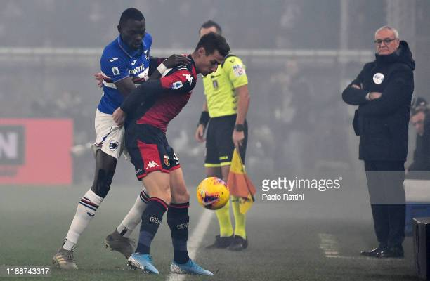 Omar Colley of UC Sampdoria and Andrea Pinamonti of Genoa CFC compete for the ball during the Serie A match between Genoa CFC and UC Sampdoria at...