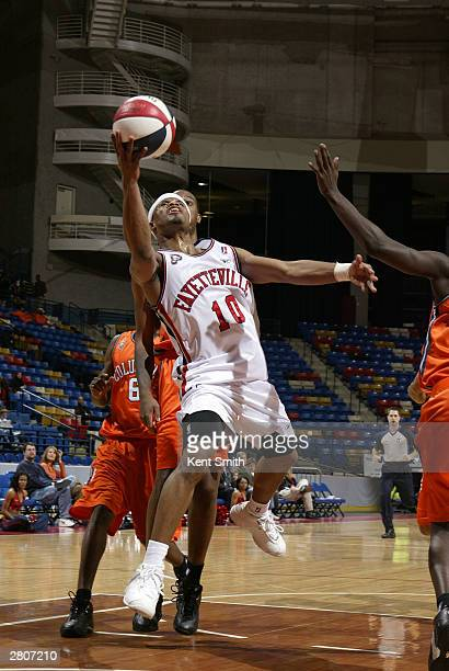 Omar Cook of the Fayetteville Patriots drives the lane for a shot attempt against the Columbus Riverdragons December 12, 2003 at the Crown Coliseum...