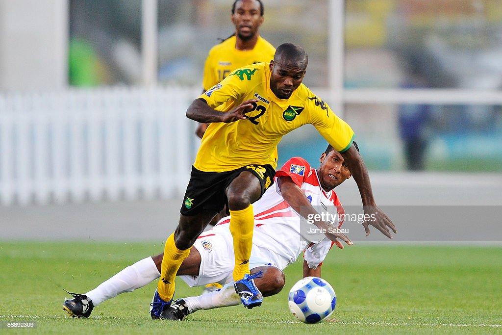 Omar Cummings #22 keeps control of the ball in front of Dario Delgado #2 of Costa Rica at Crew Stadium on July 7, 2009 in Columbus, Ohio.