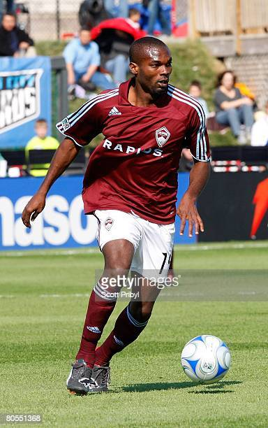 Omar Cummings of the Colorado Rapids dribbles against the Kansas City Wizards during the game at Community America Ballpark on April 5, 2008 in...