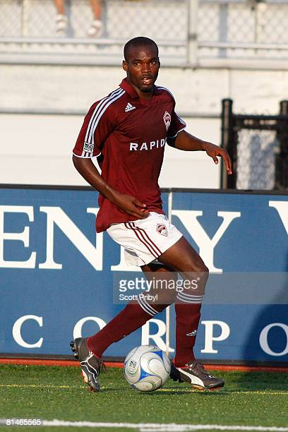 Omar Cummings of the Colorado Rapids dribbles against the Kansas City Wizards during the game at Shawnee Mission North High School on June 4 2008 in...