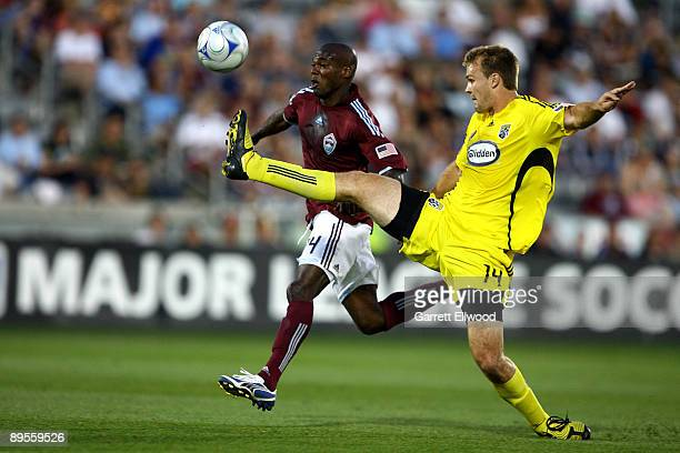 Omar Cummings of the Colorado Rapids fights for the ball against Chad Marshall of the Columbus Crew on August 1 2009 at Dicks Sporting Goods Park in...