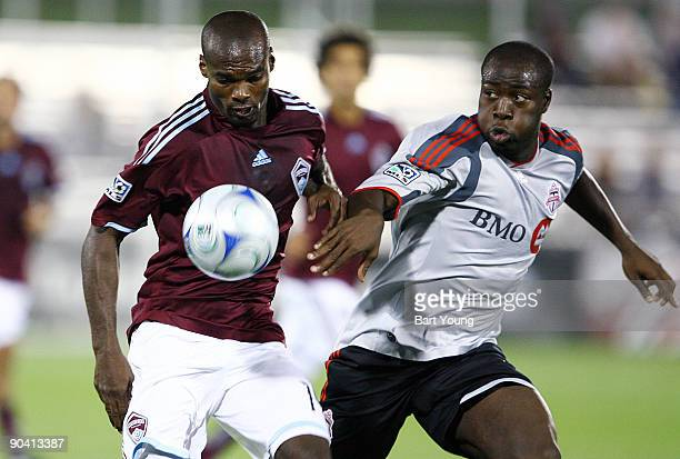 Omar Cummings of the Colorado Rapids fights for the ball against Nana Attakora of Toronto FC on September 5 2009 at Dicks Sporting Goods Park in...