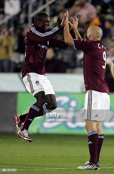 Omar Cummings of the Colorado Rapids, left, celebrates with teammate Conor Casey, right, after Casey scored a goal against the Houston Dynamo on...