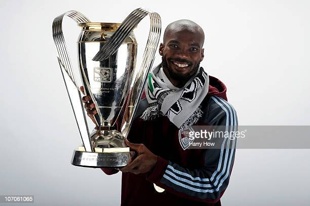 Omar Cummings of the Colorado Rapids poses with the Philip F Anschutz MLS Cup trophy following the MLS Cup final at BMO Field on November 21 2010 in...