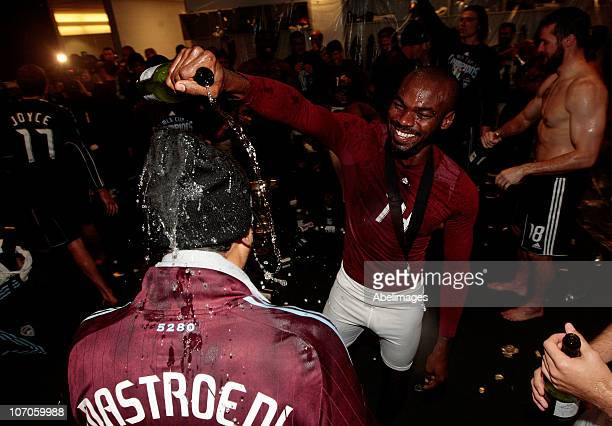 Omar Cummings of the Colorado Rapids pours champagne on caption Pablo Mastroeni while in the locker room celebrating their 21 overtime victory over...