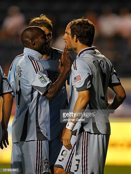 Omar Cummings of the Colorado Rapids touches the face of teammate Conor Casey during a celebration of Casey's gametying goal with teammates Scott...