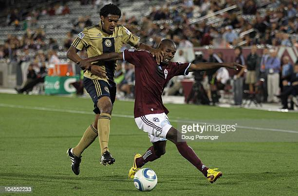 Omar Cummings of the Colorado Rapids tries to control the ball while Sheanon Williams of the Philadelphia Union defends at Dick's Sporting Goods Park...
