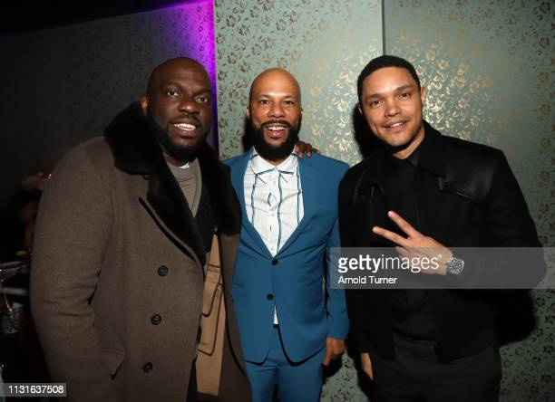 Omar Dorsey Common and Trevor Noah speak during Common's 5th Annual Toast to the Arts at Ysabel on February 22 2019 in West Hollywood California