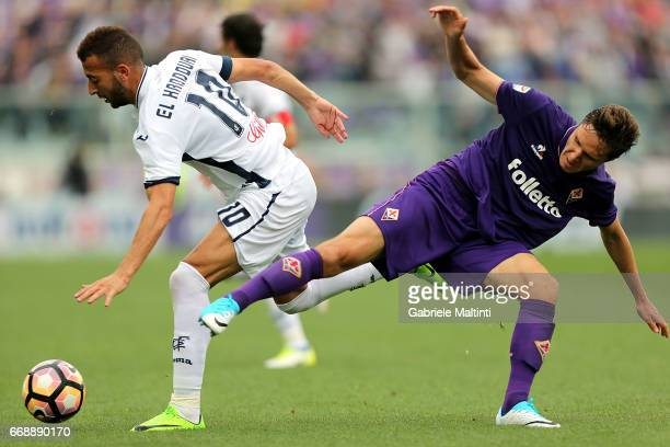 Omar El Kaddouri of Empoli FC in action against Federico Chiesa of ACF Fiorentina during the Serie A match between ACF Fiorentina and Empoli FC at...