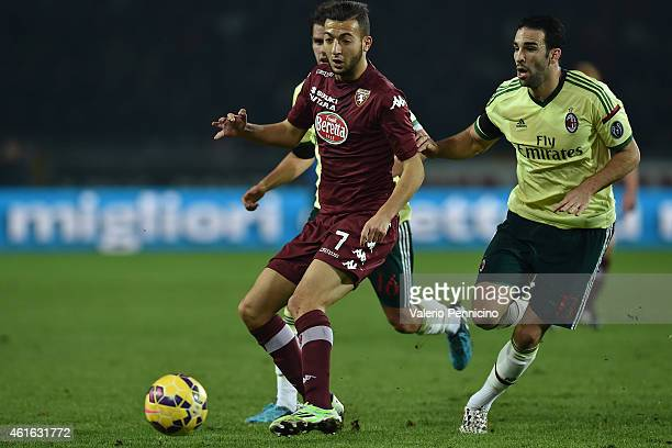 Omar El Kaddouri of Torino FC is challenged by Adil Rami of AC Milan during the Serire A match between Torino FC and AC Milan at Stadio Olimpico di...