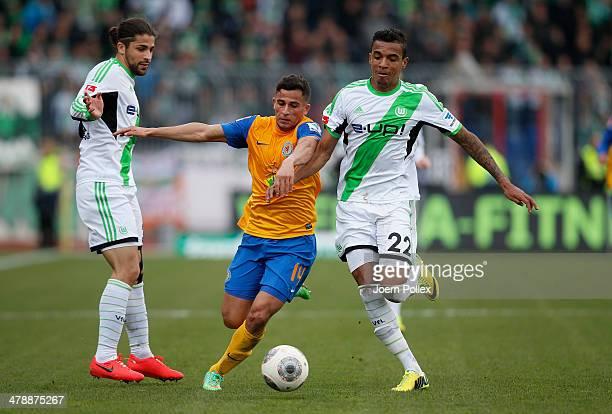 Omar Elabdellaoui of Braunschweig and Luiz Gustavo of Wolfsburg compete forthe ball during the Bundesliga match between Eintracht Braunschweig and...