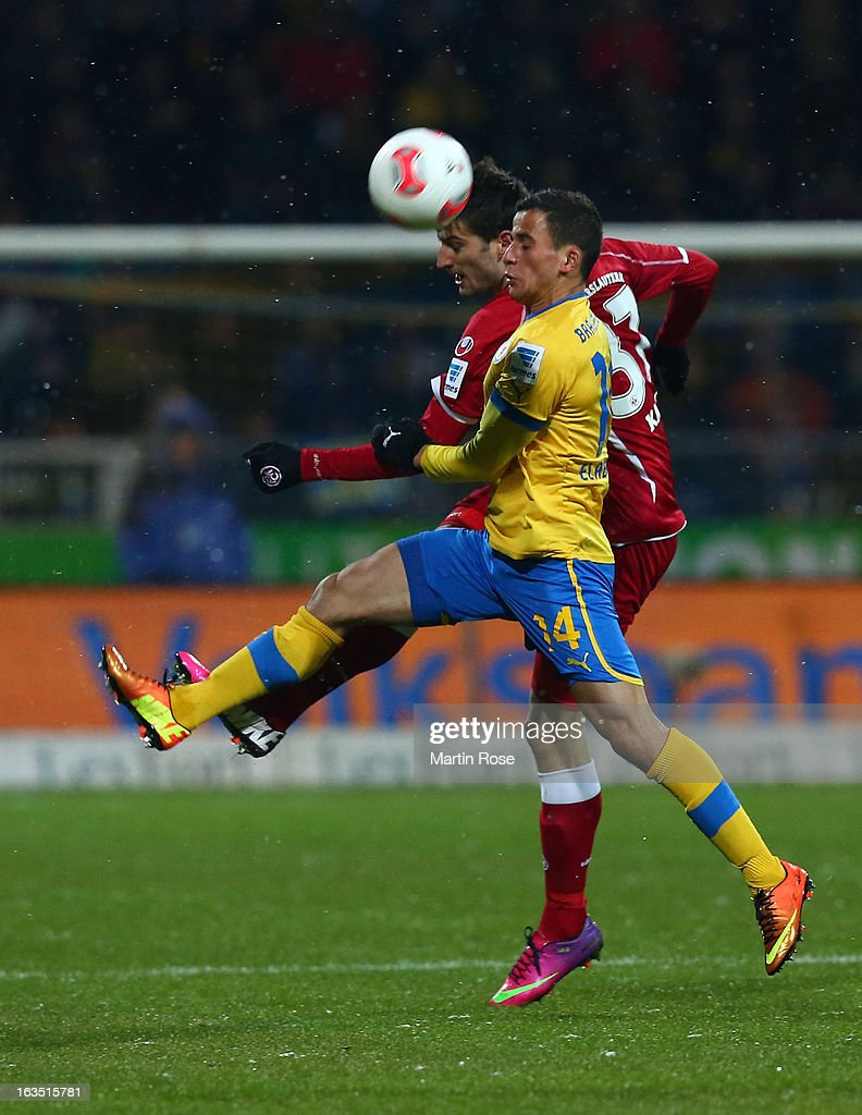 Omar Elabdellaoui (#14) of Braunschweig and Markus Karl (R) of Kaiserslautern battle for the ball during the second Bundesliga match between Eintracht Braunschweig and 1. FC Kaiserslautern at Eintracht Stadium on March 11, 2013 in Braunschweig, Germany.