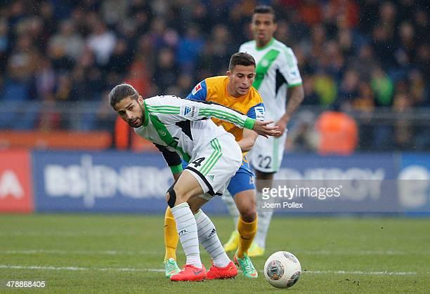 Omar Elabdellaoui of Braunschweig and Ricardo Rodriguez of Wolfsburg compete forthe ball during the Bundesliga match between Eintracht Braunschweig...