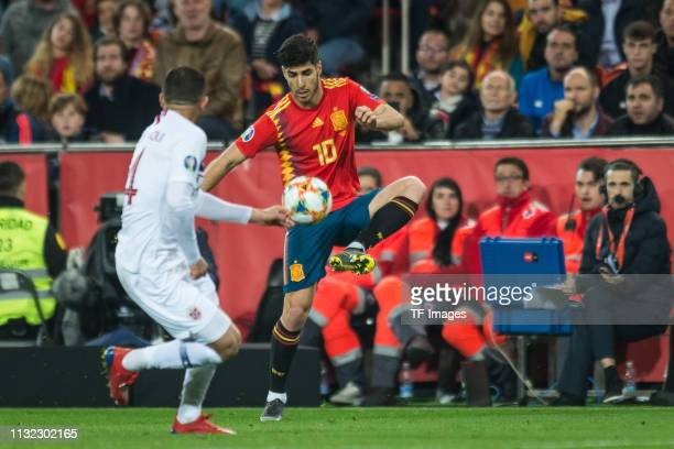 Omar Elabdellaoui of Norway and Marco Asensio of Spain battle for the ball during the 2020 UEFA European Championships group F qualifying match...