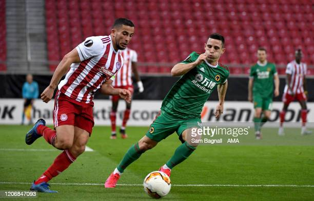 Omar Elabdellaoui of Olympiacos FC and Daniel Podence of Wolverhampton Wanderers during the UEFA Europa League round of 16 first leg match between...