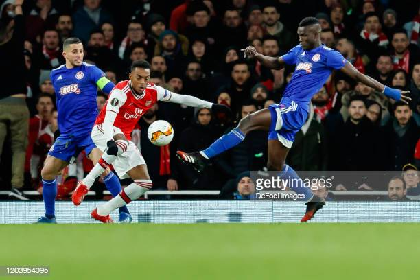 Omar Elabdellaoui of Olympiacos FC Joe Willock of Arsenal FC and Ousseynou Ba of Olympiacos FC battle for the ball during the UEFA Europa League...