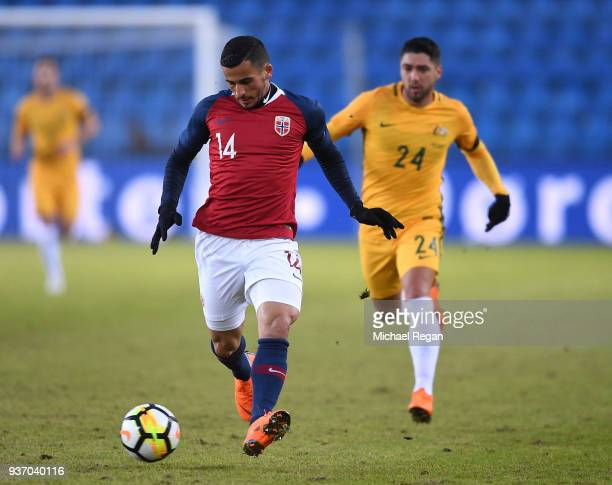 Omar Eladellaoui of Norway passes the ball back as Dimitri Petratos of Australia puts pressure on during the International Friendly match between...