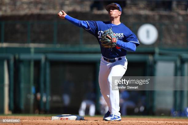 Omar Estevez of the Los Angeles Dodgers turns the double play against the Arizona Diamondbacks in the second inning of the spring training at...