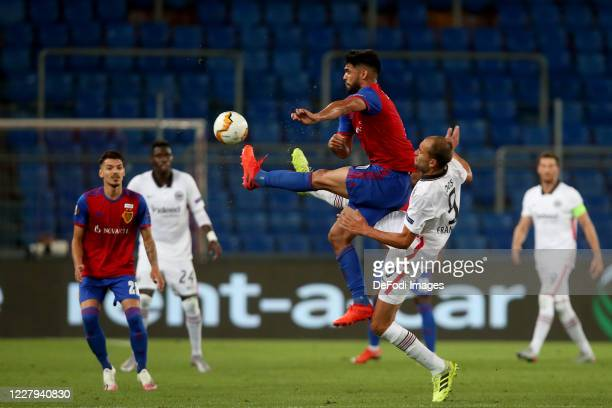 Omar Federico Alderete Fernandez of FC Basel 1893 and Bas Dost of Eintracht Frankfurt battle for the ball during the UEFA Europa League round of 16...