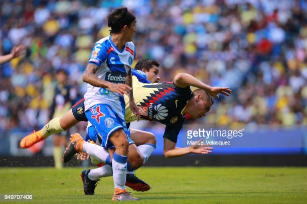 Omar Fernandez and Alonso Zamora of Puebla fight for the ball with Paul Aguilar of America during the 16th round match between Puebla and America as...