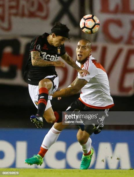 Omar Fernandez of Melgar fights for the ball with Jonatan Ramon Maidana of River Plate during a match between River Plate and FBC Melgar as part of...