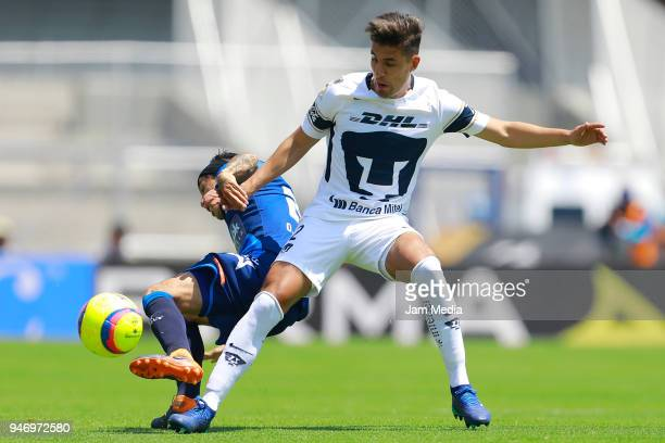Omar Fernandez of Puebla and Josecarlos Van Rankin of Pumas fight for the ball during the 15th round match between Pumas UNAM and Puebla as part of...