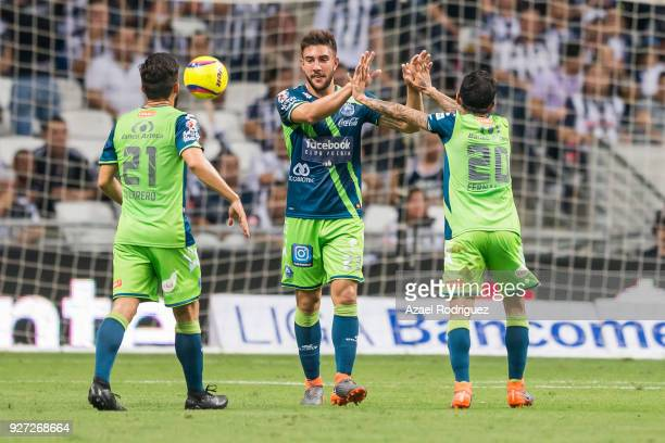 Omar Fernandez of Puebla celebrates with teammates after scoring his team's first goal during the 10th round match between Monterrey and Puebla as...