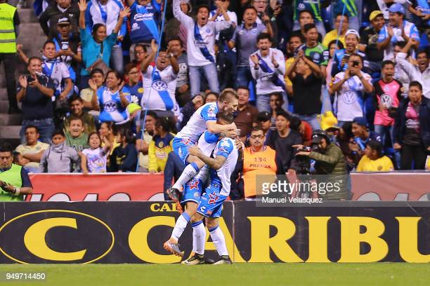 Omar Fernandez of Puebla celebrates with teammates after scoring the second goal of his team during the 16th round match between Puebla and America...