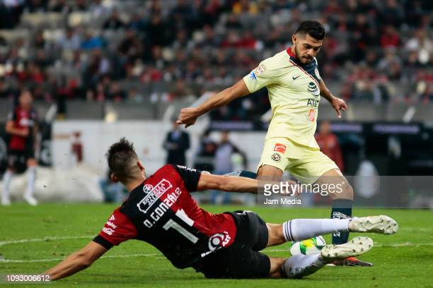 Omar Gonzalez of Atlas fights for the ball with Henry Martin of America during the 2nd round match between Atlas and America as part of the Torneo...