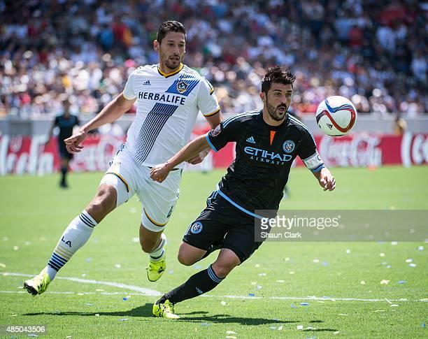 Omar Gonzalez of Los Angeles Galaxy battles David Villa of New York City FC during Los Angeles Galaxy's MLS match against New York City FC at the...