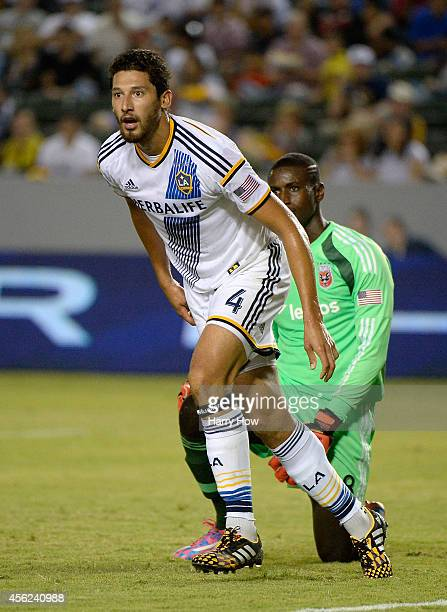 Omar Gonzalez of Los Angeles Galaxy returns to play after a collision with Bill Hamid of DC United at StubHub Center on August 27 2014 in Los Angeles...