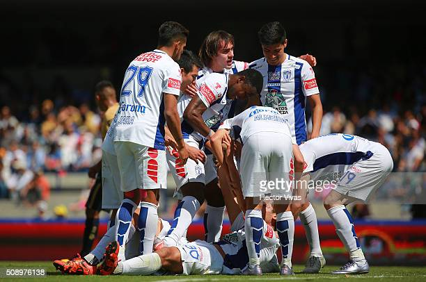 Omar Gonzalez of Pachuca celebrates with his teammates after scoring the first goal of his team during the fifth round match between Pumas and...