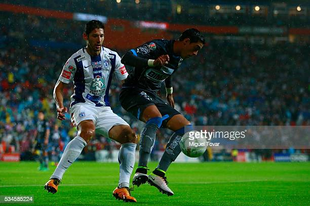 Omar Gonzalez of Pachuca fights for the ball with Rogelio Funes Mori of Monterrey during the Final first leg match between Pachuca and Monterrey as...