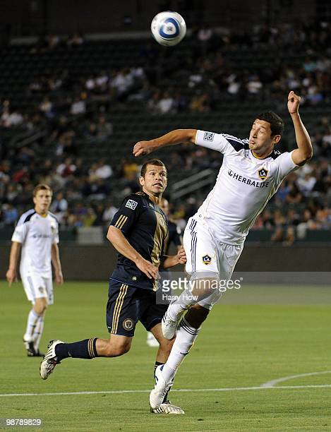 Omar Gonzalez of the Los Angeles Galaxy clears a ball in front of Alejandro Moreno of the Philadelphia Union during the first half at the Home Depot...