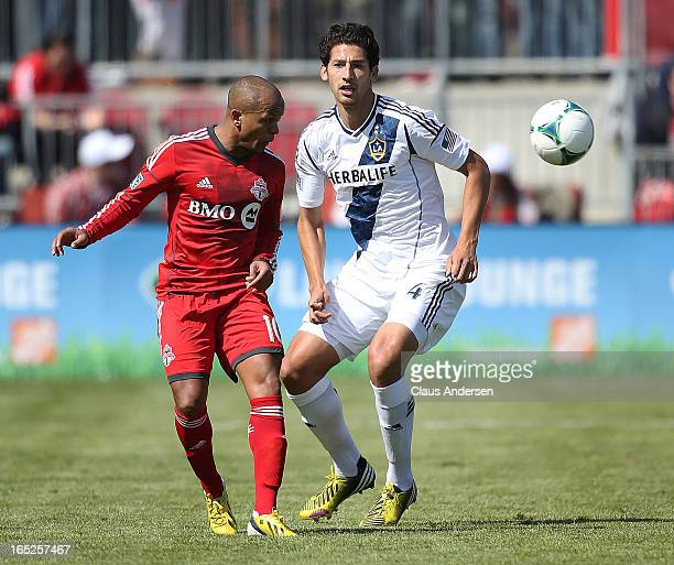 Omar Gonzalez of the Los Angeles Galaxy keeps an eye on Robert Earnshaw of Toronto FC in an MLS game on March 30 2013 at BMO field in Toronto Ontario...
