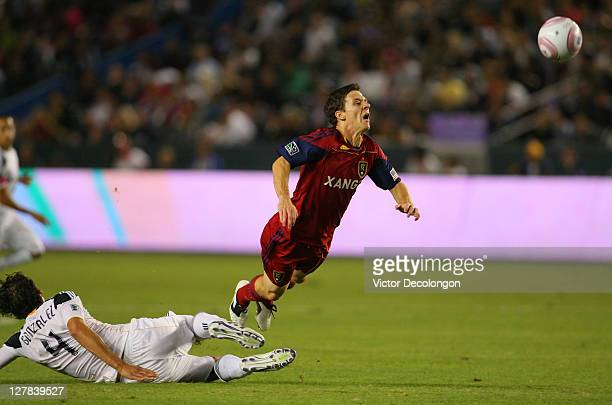 Omar Gonzalez of the Los Angeles Galaxy tackles Will Johnson of Real Salt Lake in the first half during the MLS match at The Home Depot Center on...