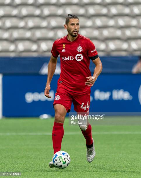 Omar Gonzalez of the Toronto FC runs the ball during MLS soccer action against the Vancouver Whitecaps at BC Place on September 5, 2020 in Vancouver,...