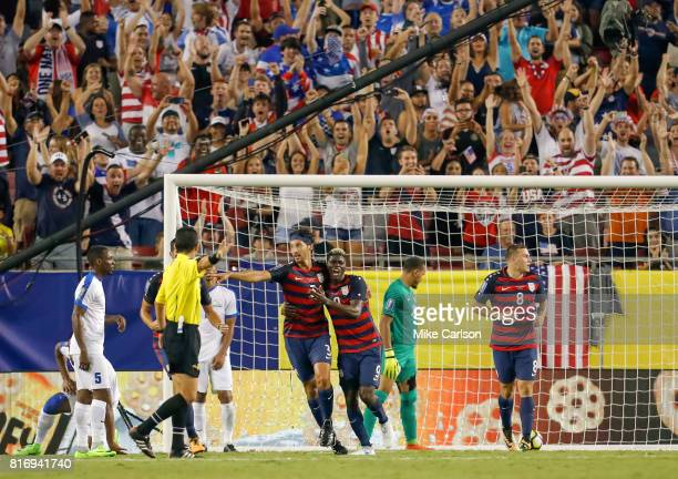 Omar Gonzalez of the United States celebrates a goal with Gyasi Zardes against Martinique during the second half of the CONCACAF Group B match at...