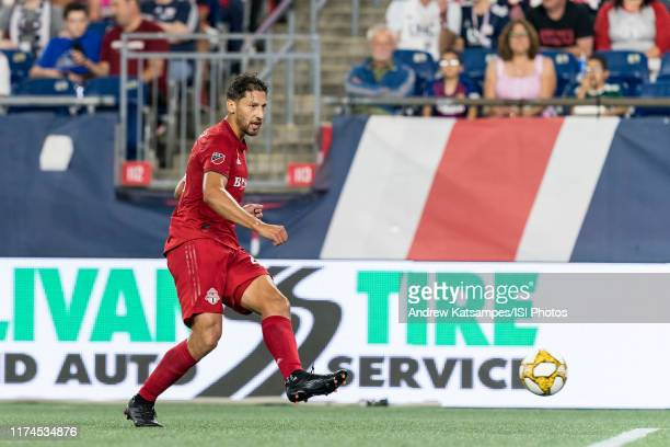 Omar Gonzalez of Toronto FC passes the ball during a game between Toronto FC and New England Revolution at Gillette Stadium on August 31, 2019 in...