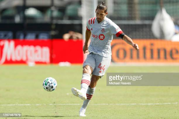 Omar Gonzalez of Toronto FC runs with the ball against the New England Revolution during a Group C match as part of the MLS Is Back Tournament at...