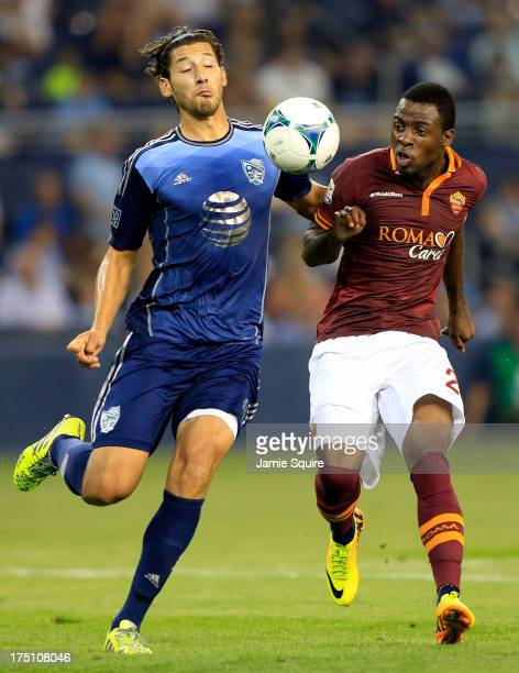 Omar González of the MLS All-Stas battles Junior Tallo of AS Roma for the ball during the 2013 Major League Soccer All Star Game at Sporting Park on...