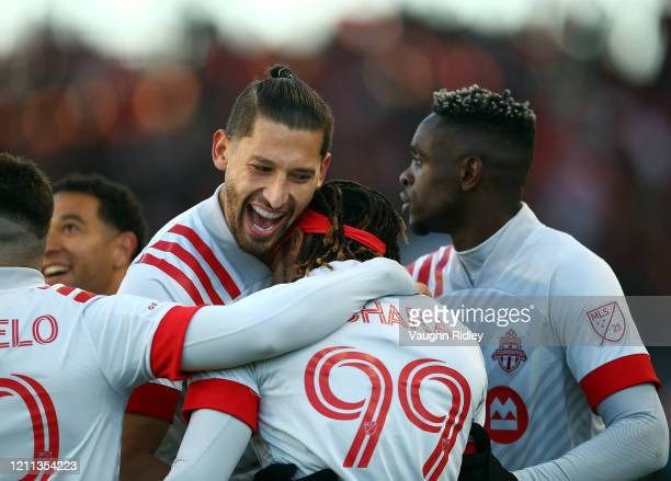Omar González of Toronto FC celebrates a goal by Ifunanyachi Achara that was eventually ruled offside during the first half of an MLS game against...