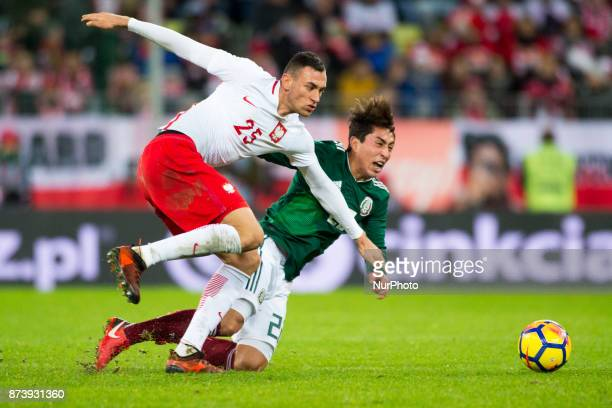 Omar Govea of Mexico fouled by Jaroslaw Jach of Poland during the International Friendly match between Poland and Mexico at Energa Stadium in Gdansk...