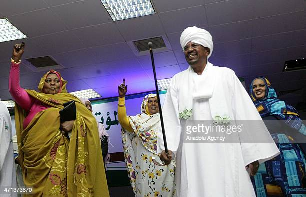 Omar Hassan al-Bashir and his wife Fatma Halid greet his supporters after he won the presidential election, in Khartoum, Sudan on April 27, 2015....
