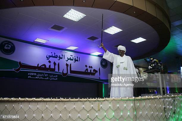Omar Hassan alBashir greets his supporters after he won the presidential election in Khartoum Sudan on April 27 2015 With a result widely predicted...