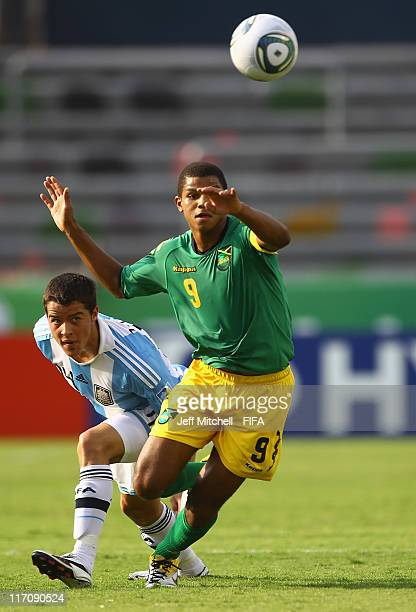 MONTERREY MEXICO JUNE Omar Holness of Jamaica beats Alexis Zarate of Argentina to the ball during the Group B FIFA U17 World Cup between Jamaica and...